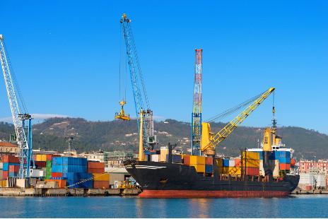 Container ship and crane in the harbor of La Spezia, Liguria, Italy