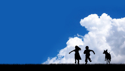 children and dog running on blue sky background.